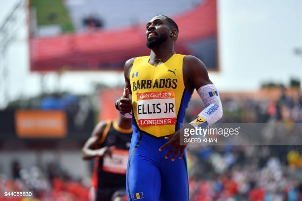 Barbados's Burkheart Ellis competes in the athletics men's 200m heats during the 2018 Gold Coast Commonwealth Games at the Carrara Stadium on the...