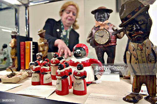 Barbara Ahntholz a parttime Christie's employee straightens items in a case during a preview of an upcoming Christie's auction of 'The Personal...