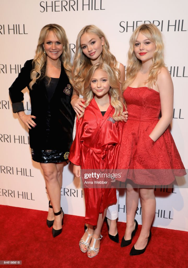 Barbara Alyn Woods, Emily Alyn Lind, Alyvia Alyn Lind, and Natalie Alyn Lind attend the Sherri Hill NYFW SS18 runway show at Gotham Hall on September 12, 2017 in New York City.