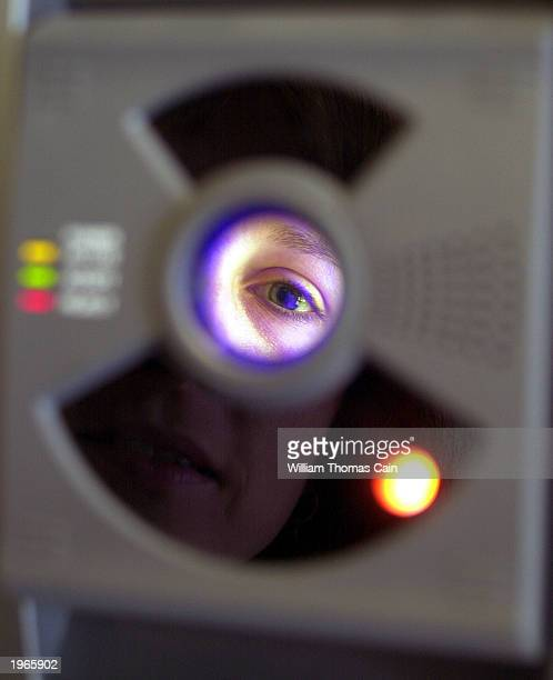 Barbara Amburgey uses the Iris Acces system to enter New Egypt Elementary School May 1 2003 in New Egypt New Jersey The irisscanning technology is...