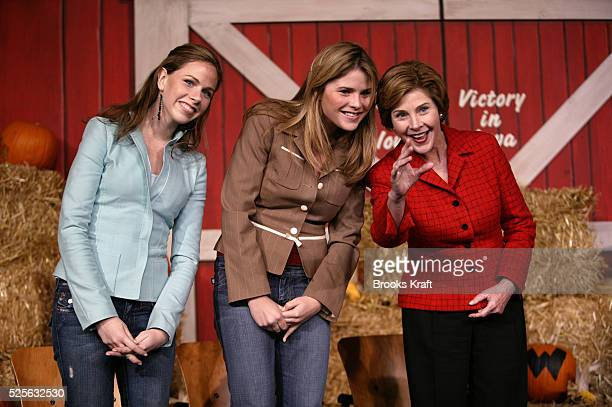 Barbara and Jenna Bush attend a campaign rally for their father President George W Bush with first lady Laura Bush in Sioux City Iowa on the last...