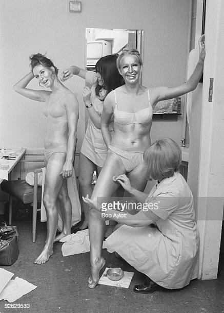 Barbara 'Babs' Lord and Patricia 'Dee Dee' Wilde of British TV dance troupe Pan's People being painted gold before their appearance on the Christmas...