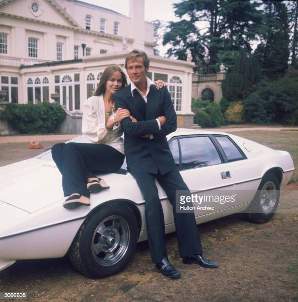 Barbara Bach and Roger Moore stars of the James Bond film 'The Spy Who Loved Me' leaning on the nowfamous 'amphibious' Lotus Esprit