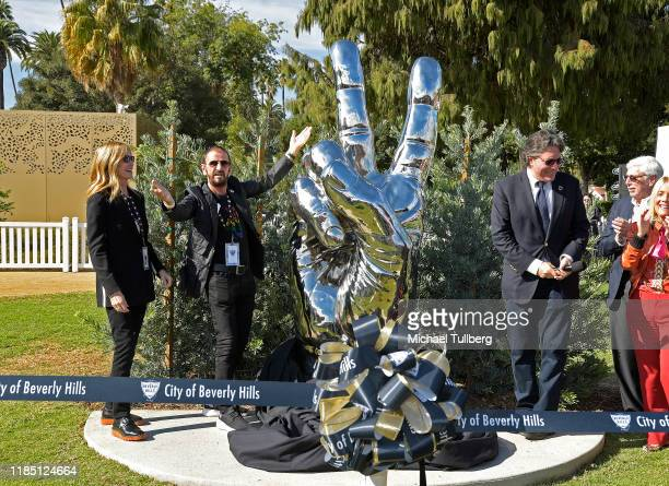 Barbara Bach musician Ringo Starr and Beverly Hills Mayor John Mirisch unveil Starr's donated sculpture Peace and Love at Beverly Gardens Park on...