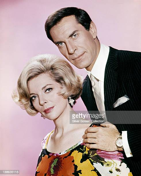 Barbara Bain US actress and Martin Landau US actor pose in a studio portrait against a pink background issued as publicity for the US television...