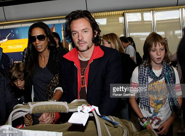 Barbara Becker and husband Arne Quinze and Elias Becker arrive for their wedding at Tegel airport on September 11 2009 in Berlin Germany