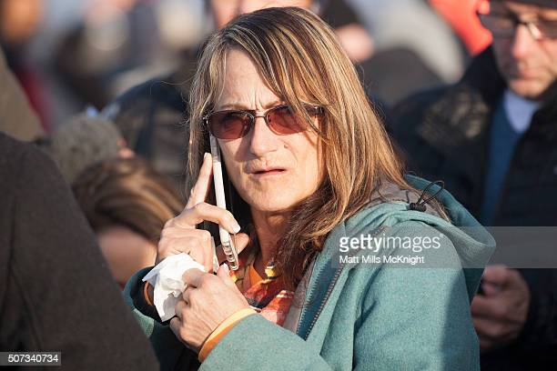 Barbara Berg a protest sympathizer and acting liaison between occupiers and FBI speaks on the phone amid a crowd of media after being at the Malheur...