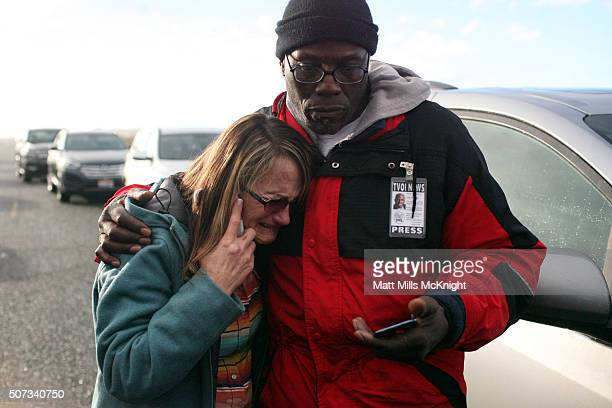 Barbara Berg a protest sympathizer and acting liaison between occupiers and FBI cries outside a new road block that was setup at the Malheur National...