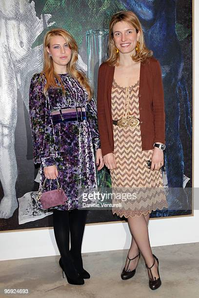 Barbara Berlusconi and Martina Mondadori attend the Jorg Immendorff show at the Cardi Black Box Gallery on January 21 2010 in Milan Italy