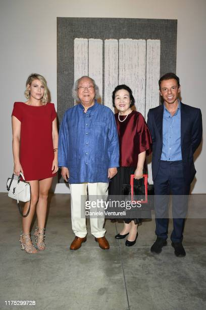 Barbara Berlusconi Ha ChongHyun a guest and Nicolo Cardi attend the Ha ChongHyun Exhibition Opening on September 17 2019 in Milan Italy