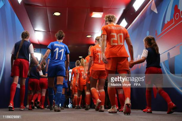 Barbara Bonansea of Italy and Dominique Bloodworth of the Netherlands wait to walk out of the tunnel prior to the 2019 FIFA Women's World Cup France...