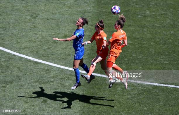 Barbara Bonansea of Italy competes for a header with Merel Van Dongen and Dominique Bloodworth of the Netherlands during the 2019 FIFA Women's World...