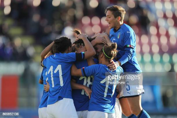 Barbara Bonansea with her teammates of Italy celebrates after scoring the team's third goal during the FIFA Women's World Cup Qualifier match between...