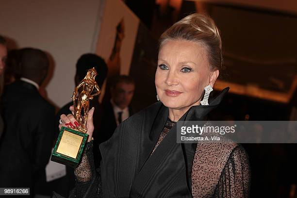 Barbara Bouchet receives the 'David Di Donatello' for Best Foreign Movie for 'Inglorious Bastards' during the Italian Movie Awards ceremony on May 7...