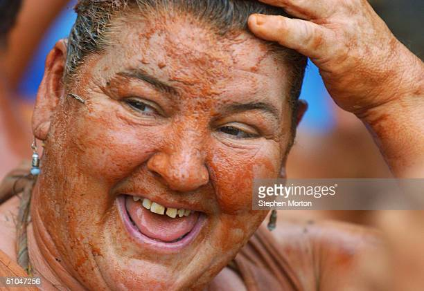 Barbara Braswell smiles after winning the Mud Pit Belly Flop contest July 10, 2004 during the 9th Annual Summer Redneck Games in East Dublin,...