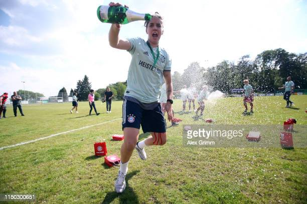 Barbara Brecht of Muenchen csprays with champagne after the 2. Frauen Bundesliga match between TSG 1899 Hoffenheim II and FC Bayern Muenchen II at...