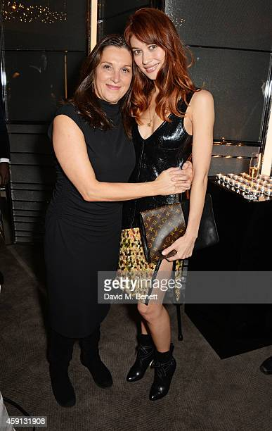 Barbara Broccoli and Olga Kurylenko attend the Liberatum Cultural Honour for Francis Ford Coppola at The Bulgari Hotel on November 17 2014 in London...