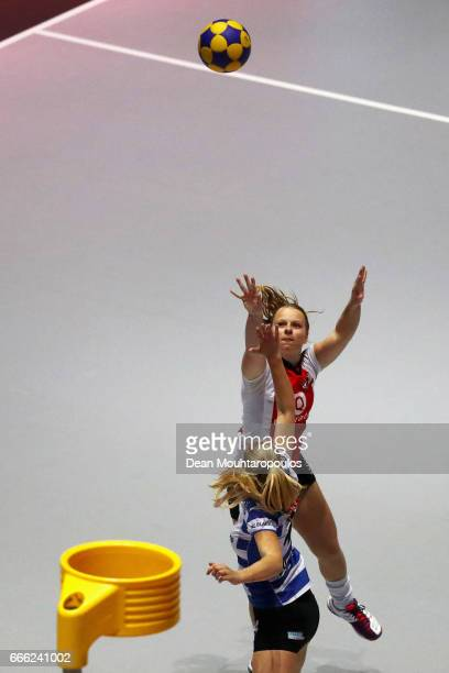 Barbara Brouwer of Top/Quoration shoots in front of Marloes Frieswijk of BlauwWit during the Dutch Korfball League Final between BlauwWit and...