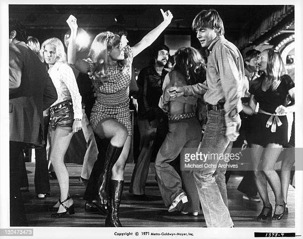 Barbara Brownell And JanMichael Vincent cut loose on the dance floor at a night club in a scene from the film 'Going Home' 1971