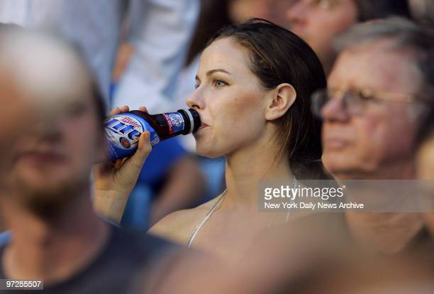 Barbara Bush daughter of President George W Bush has a beer as she takes in a game between the New York Yankees and the Atlanta Braves at Yankee...