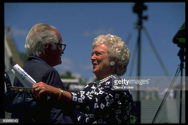 Barbara Bush extending warm greeting to former Sen Barry Goldwater during Air Force Academy Falcon graduation fete