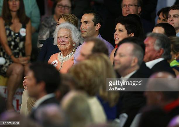 Barbara Bush sits with her grandson George P Bush as they listen to her son former Florida Governor Jeb Bush announce his plan to seek the Republican...