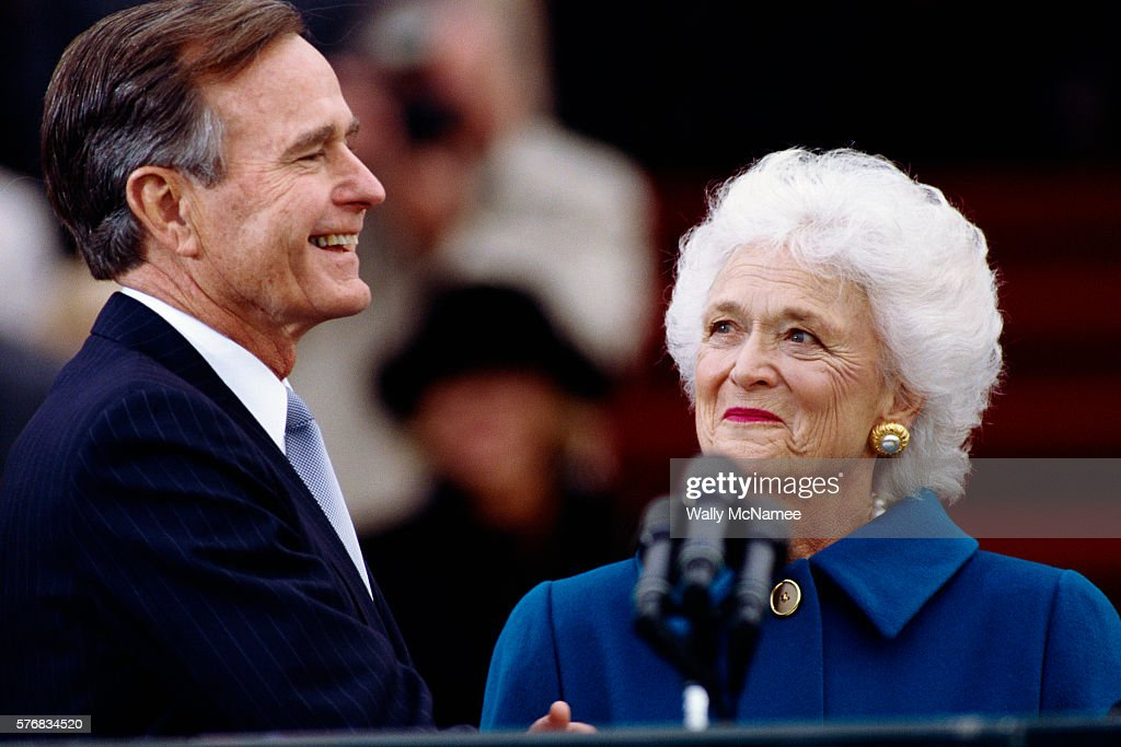 Barbara Bush watches husband, George Bush, smile following his inauguration ceremony as 41st President of the United States outside the U.S. Capitol on January 20, 1989.