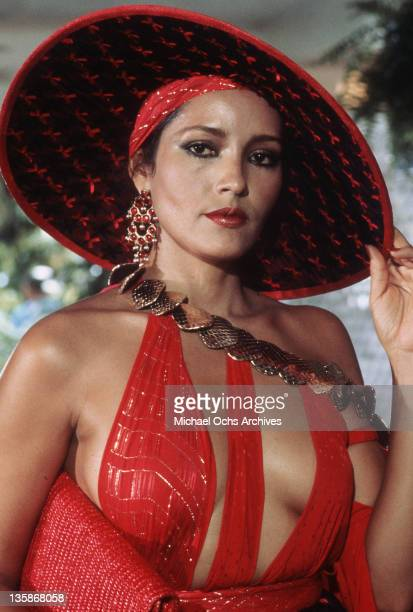 Barbara Carrera touching hat in a scene from the film 'Never Say Never', 1983.