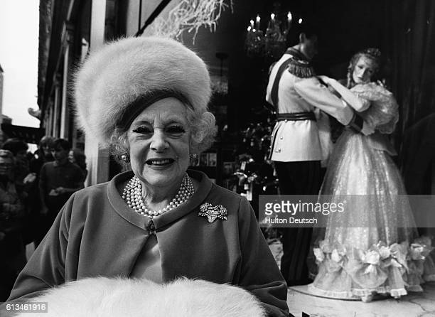 Barbara Cartland , the popular romantic novelist who is one of the World's bestselling authors, outside her window display at Selfridges, London. .