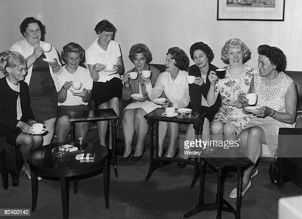 Barbara Castle Secretary of State for Employment and Productivity shares a cup of tea with the leaders of the female machinists' strike from the Ford...