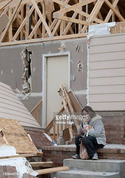Barbara Cline and her dog Daisy sit on the steps of her home on Sunday April 15 at the Meadow Lake Beach neighborhood in Wichita Kansas the day after...