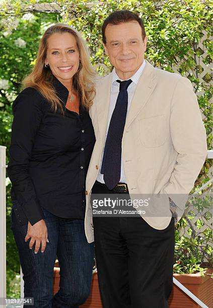 Barbara De Rossi and Massimo Ranieri attend a photocall for Napoli Milionaria at Hotel Westin Palace on April 13 2011 in Milan Italy