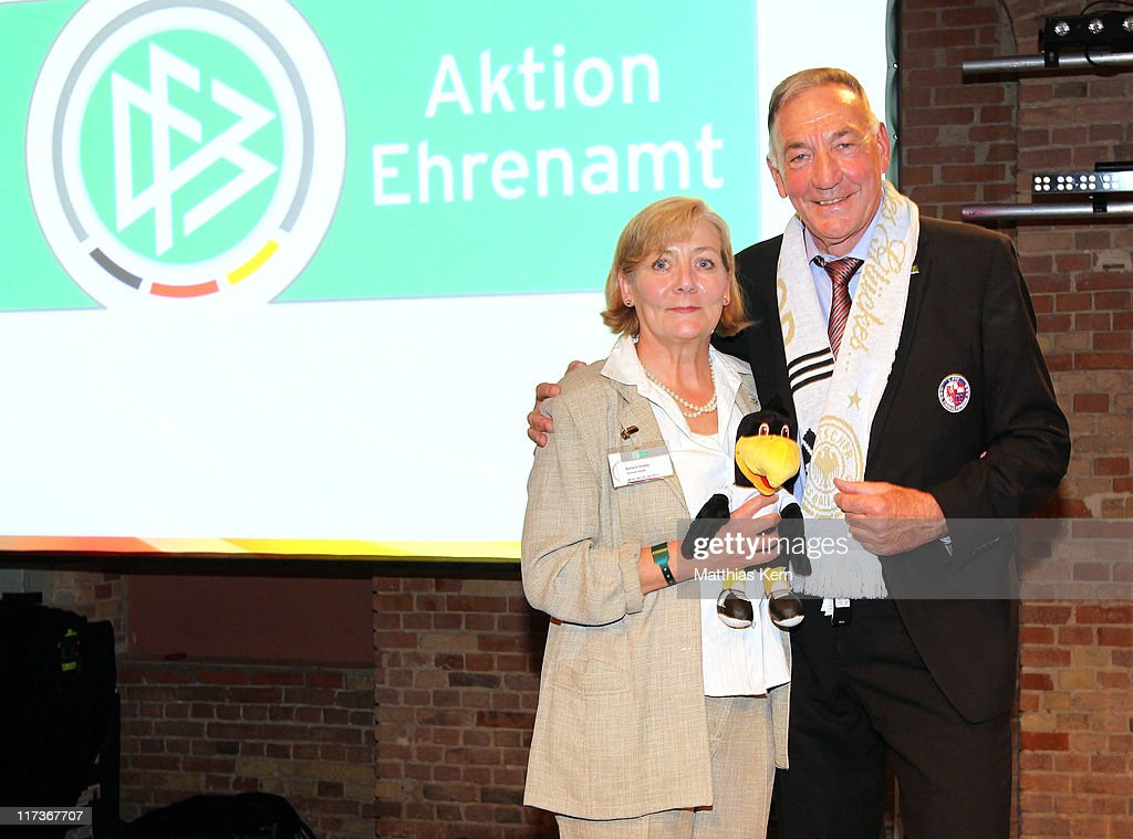 Barbara Demter (L) and head coach Bernd Schroeder (R) of Turbine Potsdam pose during the DFB Club 100 Award 2011 at Insel Eiswerder on June 26, 2011 in Berlin, Germany.