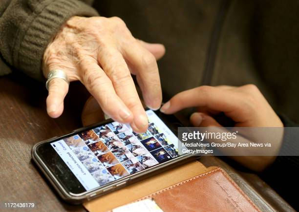 Barbara Eckhardt left gets help with using her smartphone from Noor Ul Ain Ali at the Open House Senior Center in El Cerrito Calif on Wednesday March...