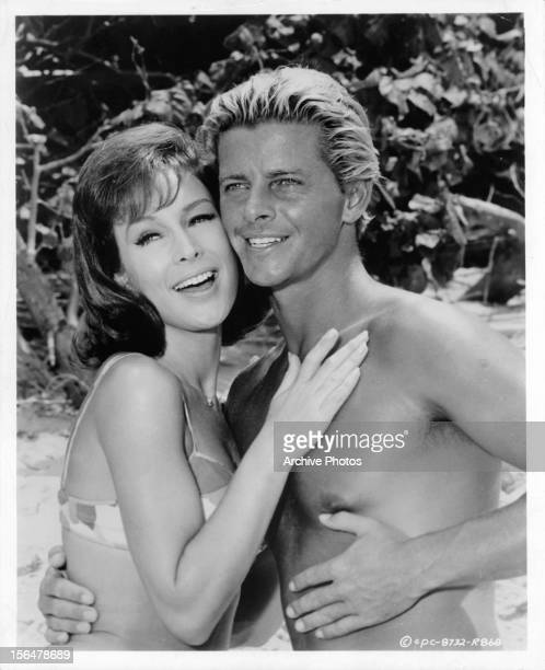 Barbara Eden and Peter Brown embracing in a scene from the film 'Ride The Wild Surf' 1964