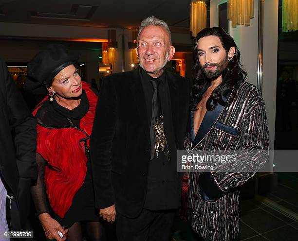 Barbara Engel Jean Paul Gaultier and Conchita Wurst at 'THE ONE Grand Show' premiere at FriedrichstadtPalast on October 6 2016 in Berlin Germany
