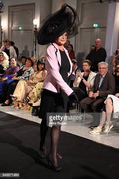 Barbara Engel walks the runway during the fashion staging of the fairy tale 'Die zertanzten Schuhe' by Harald Gloeoeckler at Hotel de Rome on June 27...