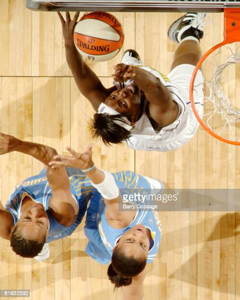 Barbara Farris of the Phoenix Mercury shoots against Chasity Melvin and Candice Dupree of the Chicago Sky on June 20 at U.S. Airways Center in...