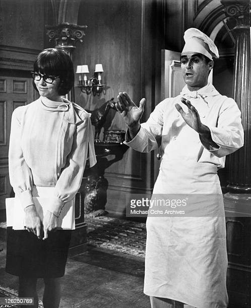 Barbara Feldon is amused by Albert Carrier in a scene from the film 'Fitzwilly' 1967