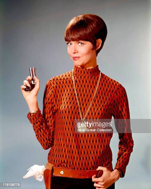 Barbara Feldon US actress poses with a small handgun in a publicity portrait for the US television series 'Get Smart' USA circa 1965 Feldon starred...