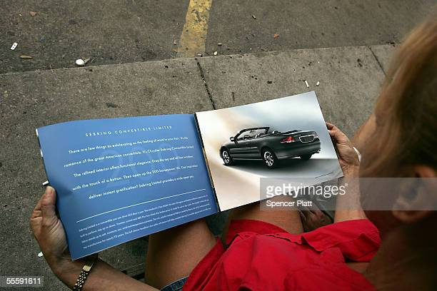 Barbara Ferguson who lost her car in Hurricane Katrina looks at a brochure for new vehicles outside of Bayside Chrysler Dodge and Jeep car dealership...