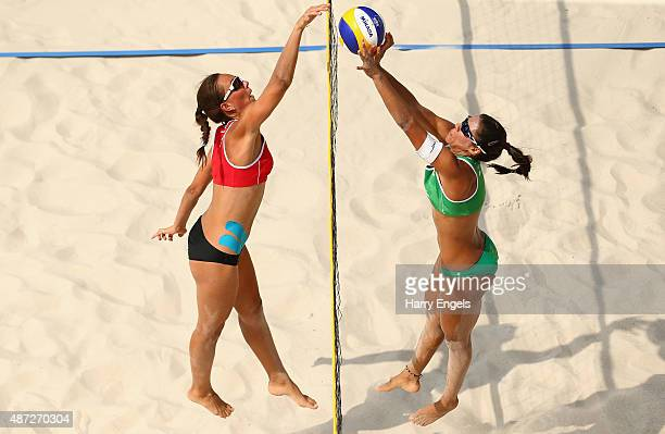 Barbara Ferreira De Sousa Alves of Brazil competes for the ball with Viktoryia Siakretava during the Women's Qualification match between Eunyce...