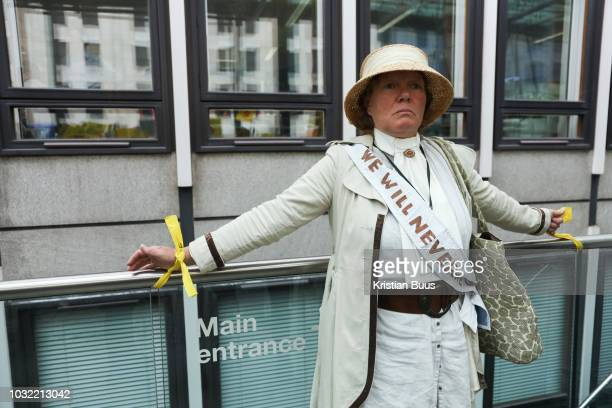 Barbara from Lancashire tied onto the railings at Dep For Energy Business and Industrial Strategy in a symbolic protest against frackingUp to a...