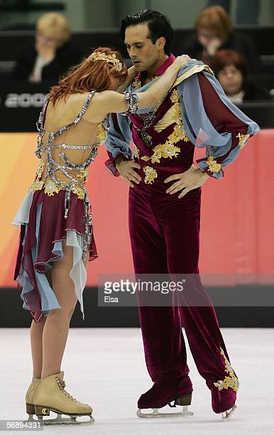 Barbara Fusar Poli and Maurizio Margaglio of Italy embrace at the end of their performance during the Free Dance program of the figure skating during...