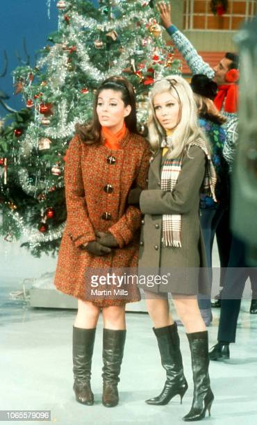 Barbara Gail Martin and Nancy Sinatra sing on stage during the 'The Dean Martin Variety Show' circa December 1967 in Los Angeles California