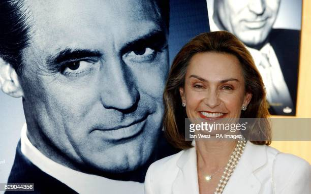 Barbara Grant Jaynes Cary Grant's widow poses in front of a poster of her late husband as she arrives for the screening of documentary Cary Grant A...