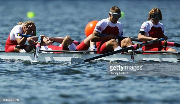 Barbara Grocholska Tomasz Kwiatkowski Piotr Blazejczyk and Anna Rudnicka of Poland show their disappointment after losing control of their boat while...
