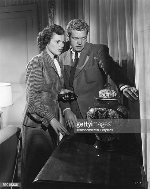 Barbara Hale and Bill Williams appear in a scene from the radio drama 'The Clay Pigeon' Hollywood California 1948