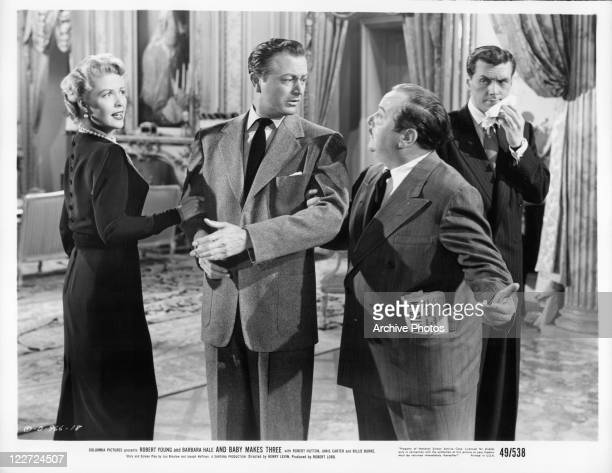Barbara Hale and Robert Young talking with unknown actor in a scene from the film 'And Baby Makes Three' 1949