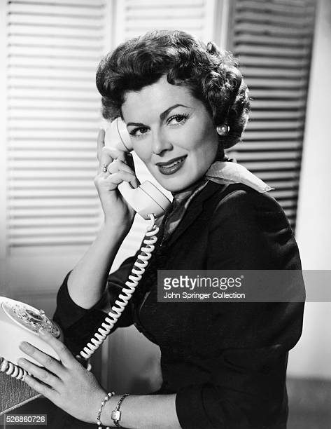 Barbara Hale answers the phone as Della Street Perry Mason's dedicated secretary on the television series Perry Mason Aired 19571966